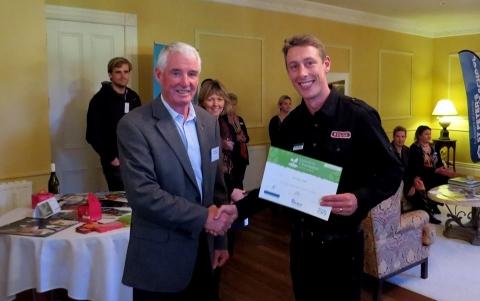 Phil receives the award from councillor Alan Livingston